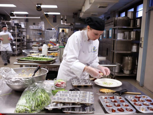 Del Mar College culinary student Carlie Stith, who received a scholarship dedicated to late business owner and baker Gary Cargile Homan, prepares for a lunch practical at the college on Wednesday, Nov. 15, 2017.