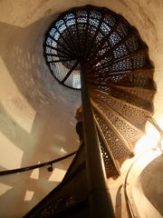 A spiral staircase leads to the Cana Island Lighthouse tower.