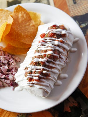 A 2013 Citizen Times file photo shows a burrito offered by the Lucky Otter restaurant in West Asheville. The restaurant will close at the end of the year.