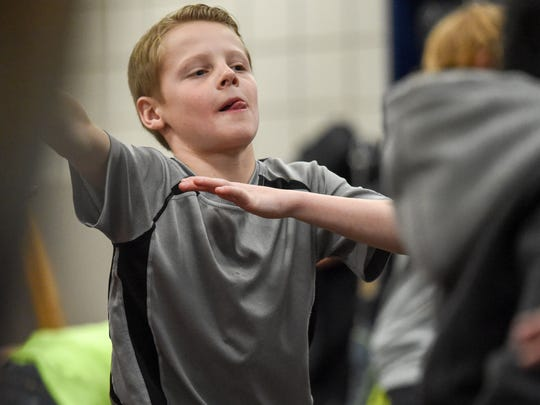 Fifth-grader Gentry Robinson struggles with a Yoga pose on Feb. 14, 2017, during Cultural Day at Jordan Creek Elementary.