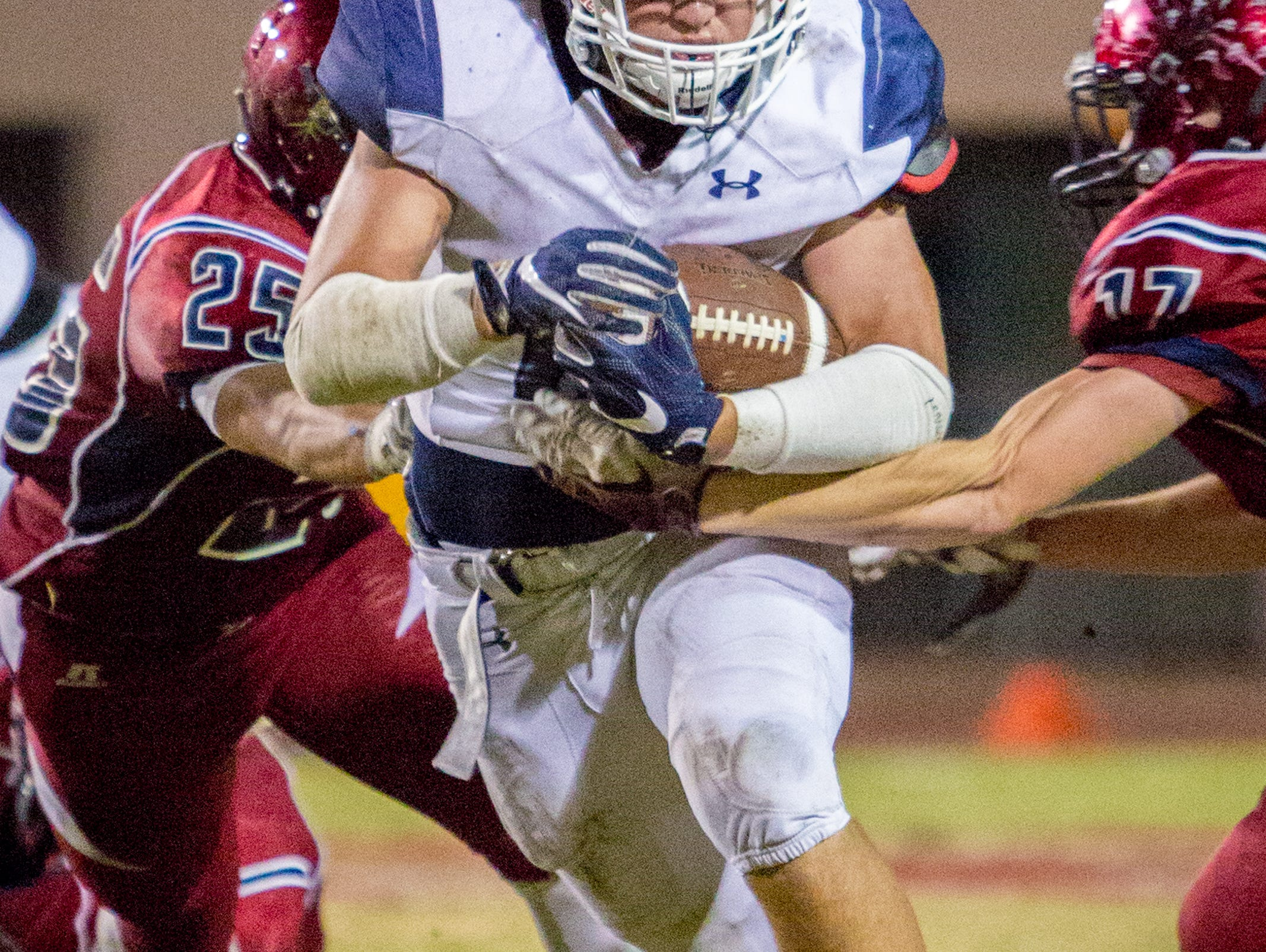 Redlands running back Doug Haugh find a hole in the middle and get a first down in a 24-10 win over La Quinta.