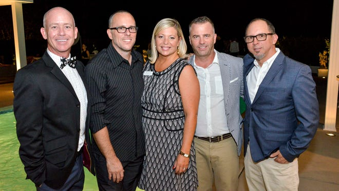 Pictured from left to right: J. Chris Mobley, Phillip K. Smith, III, Lisa Vossler Smith, Davy Aker and Paul Clemente.
