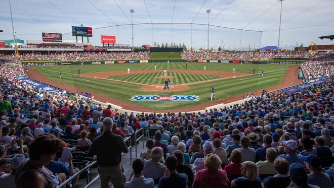 Huge crowds packed Mesa's new Cubs Park, helping the Cubs set Cactus League attendance records.