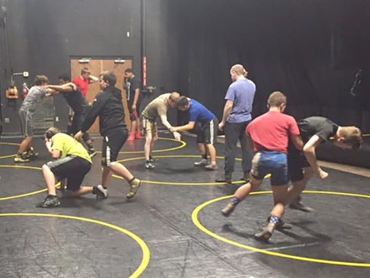 FHS Jacket wrestlers practice for first match of the season.