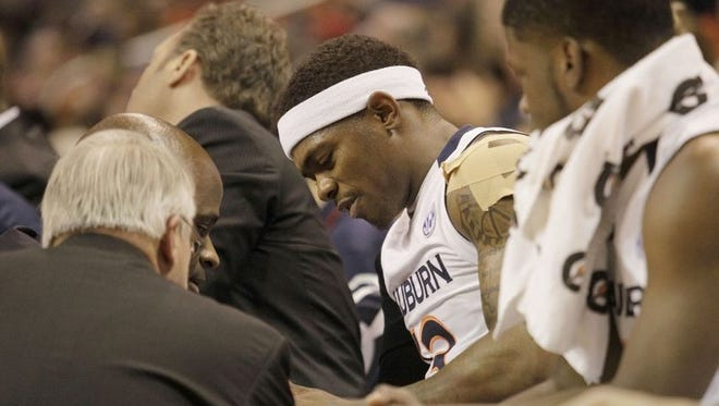 Auburn guard Tahj Shamsid-Deen (13) receives medical attention after injuring his shoulder during the first half against the Texas A&M Aggies at Auburn Arena on Jan 27, 2015.