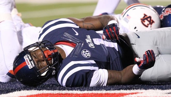 Ole Miss wide receiver Laquon Treadwell lies on the ground after suffering a broken leg on Saturday.
