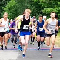 Sowa reaps 8K title in 13th annual Northville Road Runner Classic