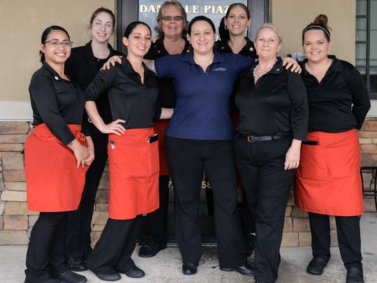 Carrabba's staff, from left, Jennifer Gallardo, Emily