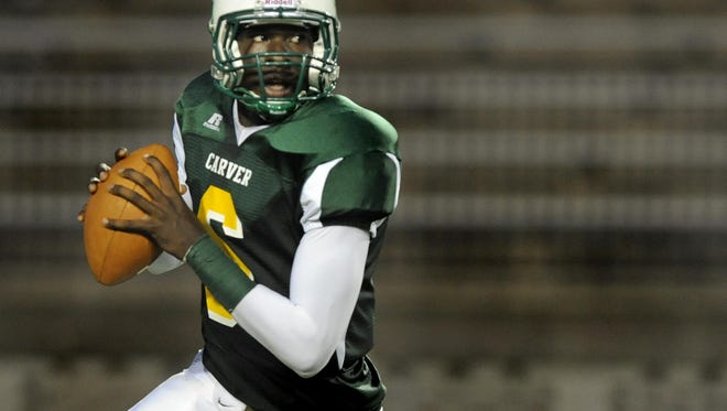 Jeremy Johnson, shown here in 2011 at Carver High School wearing No. 6, will not be switching his jersey number at Auburn to No. 1 for the 2016 season to honor former high school teammate Fred Davis.