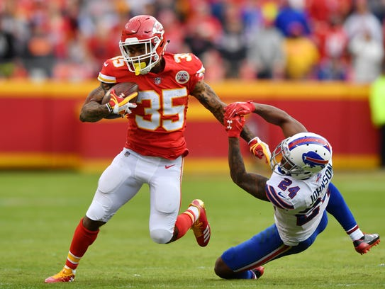 Kansas City running back Charcandrick West stiff arms Buffalo Bills defensive back Leonard Johnson  during the second half of the Bills' win on Sunday. Peter Aiken/Getty Images