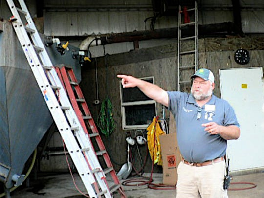 Gary Ripp explains the sand separator that allows the reuse of the sand bedding.