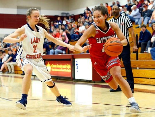 Ravenwood's Kiera Downey, right, drives against Dickson