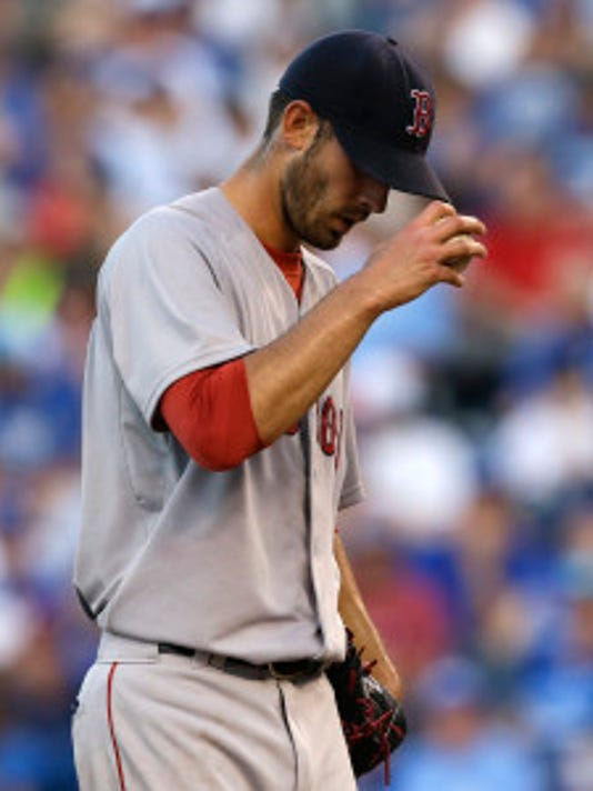 Boston pitcher Rick Porcello takes the mound after giving up a two-run home run during the fifth inning against Kansas City. (AP Photo/Orlin Wagner)
