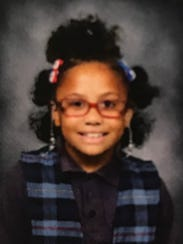 Dericka Lindsay, 9, smiles in her school photo from