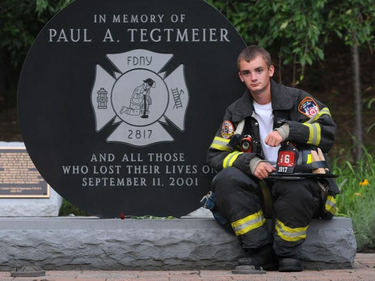 In this file photo from 2011, Aric Tegtmeier, 16, a volunteer firefighter for the Roosevelt Fire District, of Pleasant Valley, photographed at the Paul Tegtmeier Memorial Park at Hackett Hill Park in Hyde Park. Paul Tegtmeier was their father/husband, a member of the NYFD who gave his life on Sept. 11, 2001.