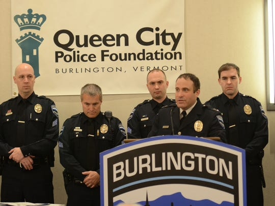 Members of the Burlington police Patrol Procedure Team stand behind chief Brandon del Pozo as they are recognized with the Distinguished Service Award during the annual Queen City Police Foundation awards luncheon on Monday, March 13, 2017, at the Hilton Hotel in Burlington.
