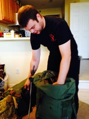 Ryan O'Leary packs a duffel bag at his West Des Moines apartment two days before leaving for Iraq last month.
