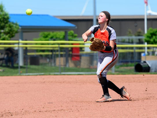 Gibsonburg's Libby Henderson makes a throw Wednesday.