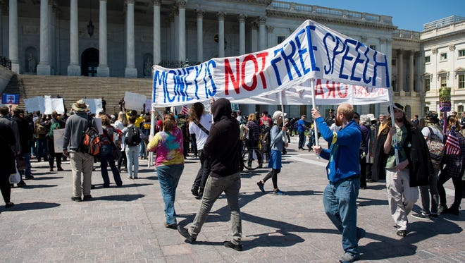 Democracy Spring protesters calling for the end of big money in politics march to the Capitol steps on the East Plaza of the Capitol on Wednesday April 13, 2016.