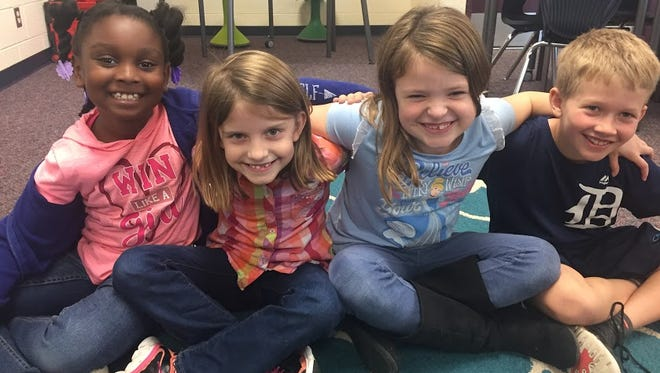 Second-graders (from left) Kai Moseley, Reaghan Conway and Alaina Beaudoin, and third-grader Jack Fedell will participate in the technology showcase in Lansing.