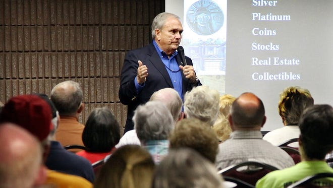 """in this file photo, Dr. Larry Bates, author of """"The Impending Financial Collapse,"""" speaks during a lecture at the Tennessee Tea Party Coalition inaugural convention at the Gatlinburg Convention Center in Gatlinburg, Tennessee Saturday, May 22, 2010."""