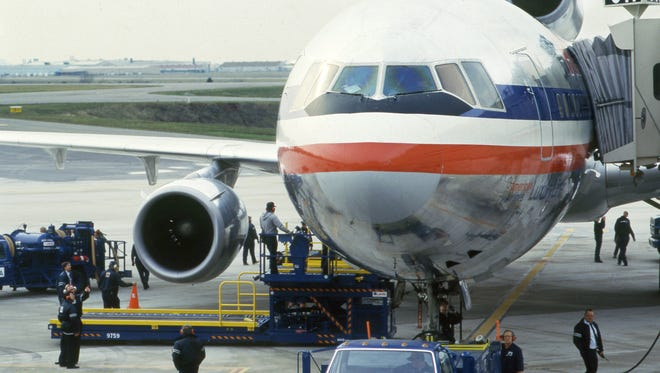 The DC-10 jet, which accommodates nine passenger seats and two aisles across the cabin, is getting ready for flight at the Nashville Municipal Airport Jan. 18, 1988. American Airlines introduced the city's first regular wide-body jet service that carries 290 passengers and features video screens for in-flight entertainment.