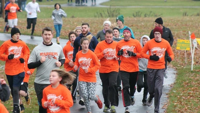 Participants complete the first Friendsgiving 5k - Tyler Kreilter 2nd Annual Memorial Run in Marine City.