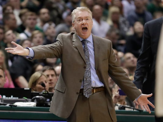 Milwaukee Bucks head coach Joe Prunty reacts to a technical foul call during the first half of an NBA basketball game against the Indiana Pacers Friday, March 2, 2018, in Milwaukee. (AP Photo/Morry Gash)