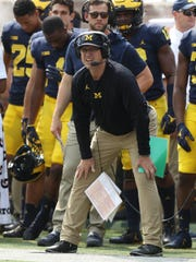Jim Harbaugh on the sideline during Michigan's 29-13
