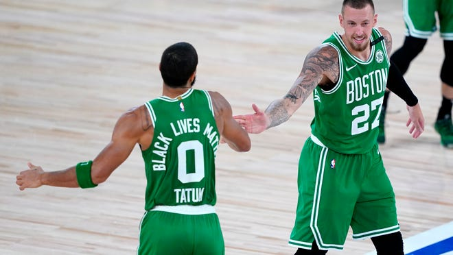The Celtics' Jayson Tatum celebrates his 3-pointer with Daniel Theis during the second half Friday night against the Raptors.
