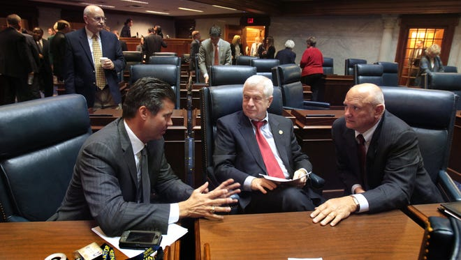 Senators, from left, Ryan Mishler, R-Bremen; Ed Charbonneau, R-Valparaiso; and Luke Kenley, R-Noblesville, confer after the Senate wrapped up a short session of business on Tuesday, January 7, 2014, as they reconvened for the 2014 session one day after the planned Monday start.