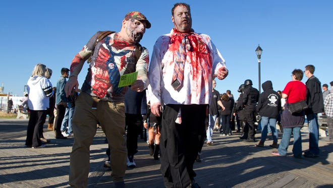 The Zombie Walk heads down the Asbury Park Boardwalk late afternoon. 