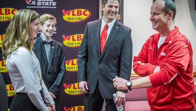 Replacement Ball State football coach Mike Neu introduces his family members to president Paul Ferguson and other Ball State coaches and staff prior to his press conference at Worthen Arena Friday.