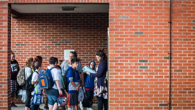 Parents and students arrive at South View Elementary between 7 a.m. and 8:15 a.m. for the first day of School Wednesday morning.