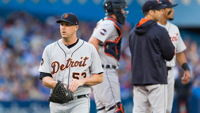 Detroit Tigers relief pitcher Warwick Saupold (53) is relieved by pitching coach Rich Dubee (52) in the sixth inning at an MLB game against the Toronto Blue Jays at Rogers Centre on Sept. 9, 2017.