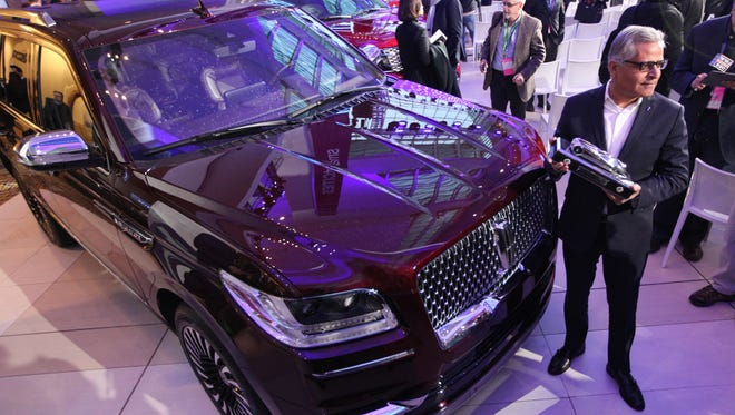 Kumar Galhotra, is group vice president, Lincoln and chief marketing officer for Ford Motor Company, holds the Truck of the Year award after for the Lincoln Navigator was tabbed the winner during the North American International Auto Show on Monday, Jan. 15, 2018.