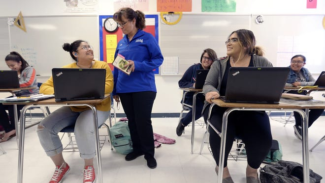 Clint Early College High School math teacher Carlota Alvarez Basurto jokes with a student in class. The Council on Regional Economic Expansion and Educational Development, or CREEED, announced it had awarded $259,000 in scholarships for teachers to receive their dual-credit credentials.