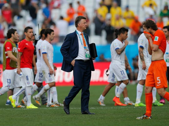 Netherlands' head coach Louis van Gaal stands on the pitch after the group B World Cup soccer match between the Netherlands and Chile at the Itaquerao Stadium in Sao Paulo, Brazil, Monday, June 23, 2014. The Dutch team beat Chile 2-0 to top Group B. (AP Photo/Frank Augstein)