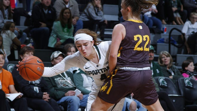 Michigan State's Taryn McCutcheon scored 15 points in the Spartans' 85-45 win over Rhode Island on Thursday.