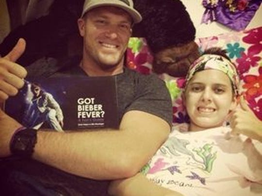 Colts long snapper Matt Overton is shown with Mia Benge, a brain tumor survivor who Overton befriended while she was being treated at Riley Hospital for Children.