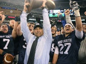 Middletown South High School head coach Steve Antonucci celebrates winning the state title against Phillipsburg in the North 2 Group IV game of the 2015 NJSIAA/MetLife Stadium High School Football Championships with his team at MetLife Stadium in East Rutherford, NJ Saturday December 5, 2015.