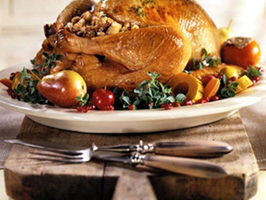 Traditional Stuffed Roast Turkey with Herb Butter