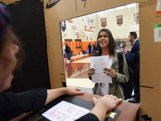 A student is given a positive message at the fortunetellers booth, sponsored by the high school's Art Honor Society.