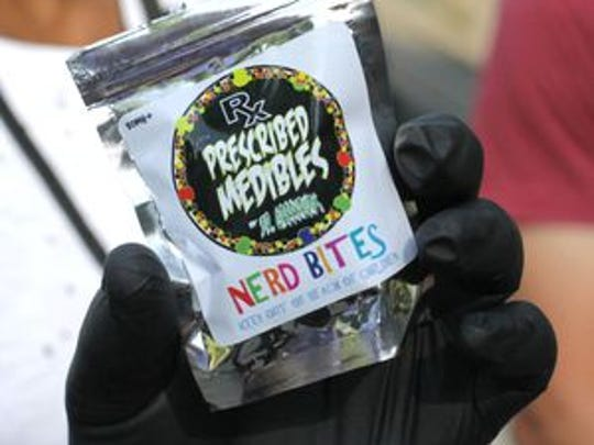 Sheriff's Capt. Donald Zehner holds a packet of the candy laced with THC that made festival goers at Ohio Dreams sick in August.