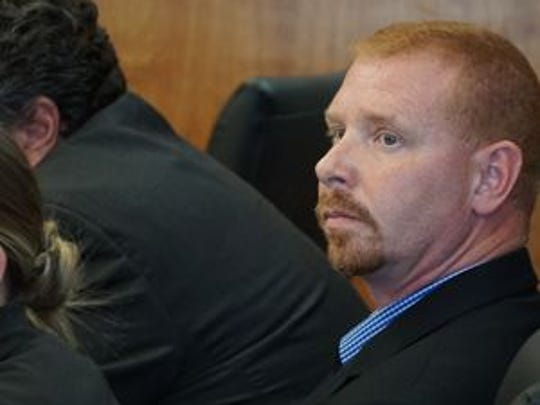 Former Mansfield police Officer Mike Garn listens during his trial in the spring of 2016.