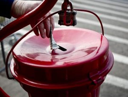 Drop some cash in a Red Kettle to help the Salvation