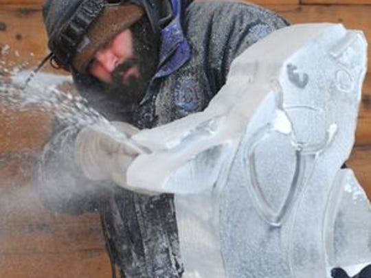 Ice sculpting is a big part of Mohican Winterfest. Jeff Meyers works on a fish at a previous event.