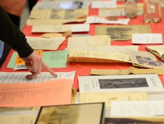 Students look through artifacts of local history displayed