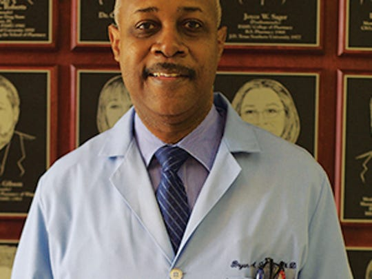 Bryan Lewis, a professor of microbiology at the FAMU College of Pharmacy and Pharmaceutical Sciences.