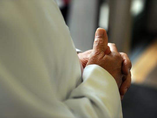 The hands of Father Jose Aurelio Ortiz-Matiz, before Easter Sunday services at Sacred Heart Church in Salinas.